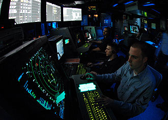 USS Abraham Lincoln (CVN-72) - An Air Traffic Controller works approach control in Carrier Air Traffic Control Center (CATCC) aboard the Nimitz class aircraft carrier USS Abraham Lincoln.