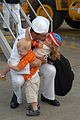 US Navy 060703-N-6247M-005 Interior Communications Electrician 2nd Class Fletcher Hendrickson hugs his children during a homecoming celebration for the guided-missile frigate USS Ford (FFG 54).jpg