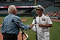 US Navy 060830-N-1805P-006 Amphibious transport dock ship USS Cleveland (LPD 7) Commanding Officer Capt. Frank McCulloch accepts a Cleveland Indians flag presented to him by Major League Baseball Hall of Fame Inductee and World.jpg