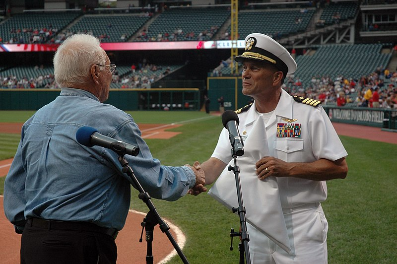 File:US Navy 060830-N-1805P-006 Amphibious transport dock ship USS Cleveland (LPD 7) Commanding Officer Capt. Frank McCulloch accepts a Cleveland Indians flag presented to him by Major League Baseball Hall of Fame Inductee and World.jpg