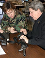 US Navy 070304-N-4034B-010 Information Systems Technician 2nd Class Kim Bradley of Jacksonville, Ark., left, and Storekeeper 1st Class Nancy Boyd of Lebanon, Tenn., examine an M-16 rifle in a weapons familiarization course.jpg