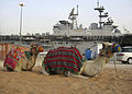 US Navy 070323-N-3286A-001 Two camels rest in front of amphibious assault ship USS Bataan (LHD 5) while the ship is moored during a port visit.jpg