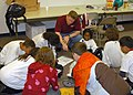 US Navy 070720-N-6247M-005 Aviation Structural Mechanic 1st Class Paul Winch teaches some children attending the Drug Education For Youth (DEFY) Program.jpg