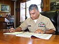 US Navy 071010-N-2529H-001 Master Chief Petty Officer of the Navy (MCPON) Joe R. Campa Jr. fills out the necessary paperwork to participate in the 2007 Combined Federal Campaign (CFC).jpg