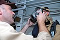 US Navy 071020-N-0193M-050 Chief Warrant Officer 2 David Manovich adjusts a Sailors gas mask during a general quarters drill aboard amphibious dock landing ship USS Fort McHenry (LSD 43).jpg