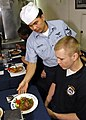 US Navy 080820-N-7280V-018 Hull Maintenance Technician 3rd Class Paris Luh enjoys an Asian-Pacific meal.jpg