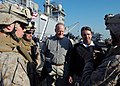 US Navy 081219-N-5681S-066 U.S. Reps. Mike Conaway, left, and Rob Whitman speak with Marines on the flight deck of the multi-purpose amphibious assault ship USS Iwo Jima (LHD 7).jpg