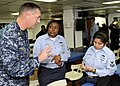 US Navy 090122-N-7280V-051 Storekeeper 2nd Class Armida Sandoval takes notes from Pacific Fleet Master Chief Tom Howard on how to succeed as a Sailor.jpg