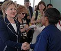 US Navy 090416-N-6259S-096 Secretary of State Hillary Rodham Clinton greets Lt. Patricia Gill in the Cite Soleil section of Port-au-Prince, Haiti.jpg