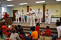 US Navy 090527-N-7375S-013 Capt. Leo Falardeau speaks to children at the Cameron Community Ministries after school program during Rochester Navy Week.jpg