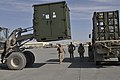 US Navy 091128-N-9584H-034 A Seabee guides an airfield ground crew loading equipment onto a truck on the Kandahar Airfield flightline.jpg