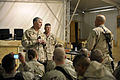 US Navy 100109-N-8273J-080 Chief of Naval Operations (CNO) Adm. Gary Roughead and Master Chief Petty Officer of the Navy (MCPON) Rick West speak with and answer questions from Sailors.jpg