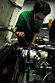 US Navy 100121-N-3485C-053 Aviation Support Equipment Technician Airman Heather Mikschl replaces a power steering pump on an aircraft towing tractor aboard the the aircraft carrier USS John C. Stennis.jpg