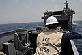 US Navy 100310-N-5700G-117 Engineman 1st Class Aaron A. Villa, from Buckeye, Ariz., prepares to pull Landing Craft Utility 1655 into the well deck of the amphibious assault ship USS Nassau (LHA 4).jpg