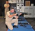 US Navy 100708-N-7682A-006 U.S. Pacific Fleet Force Master Chief Eric W. Page, hones his sharp shooting skills using the M-16A1 rifle in the firearms trainer simulator at the Gunner's Mate.jpg