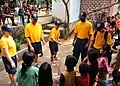 US Navy 101204-N-8721D-019 Sailors assigned to the guided-missile destroyer USS Mustin (DDG 89) play with children during a community service proje.jpg
