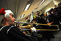 US Navy 101216-N-7364R-018 Musician 2nd Class Garrett Stephan plays a Christmas song with his trombone during an impromptu performance at Naval Sup.jpg