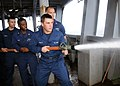 US Navy 110120-N-6165A-007 Sailors practice firefighting skills on the ship's fantail aboard USS Frank Cable (AS 40).jpg