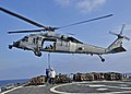 US Navy 110303-N-XO436-140 Sailors aboard USS Barry (DDG 52) attach a cargo pennant to a MH-60S Sea Hawk helicopter.jpg