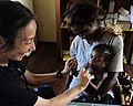 US Navy 110523-F-HS649-128 Pediatric nurse Lt. Cmdr. Rivka Weiss plays with a Papua New Guinean baby during a Pacific Partnership 2011 medical civi.jpg