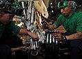 US Navy 111011-N-RJ456-143 Sailors change an axle on the landing gear of an F-A-18C Hornet.jpg