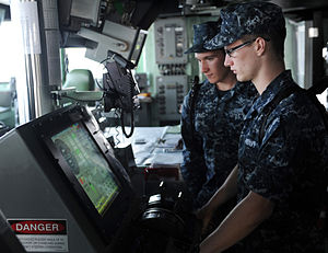 US Navy 111231-N-EK905-078 Seaman Jeremy King trains Seaman Recruit James Nolan as lee helmsman on the bridge of the amphibious assault ship USS Ma.jpg