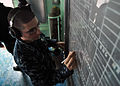 US Navy 120214-N-PV215-020 Operations Specialist Seaman Michael Scottolavino plots and reports surface contacts as the amphibious transport dock sh.jpg
