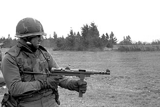 Carl Gustav m/45 - U.S. Army soldier firing an m/45B SMG during special weapons training. The soldier has an incorrect grip on the weapon and is holding the magazine. The correct way to hold it is just in front of the magazine.