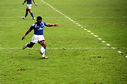 Uale Mai kicks rugby ball.jpg