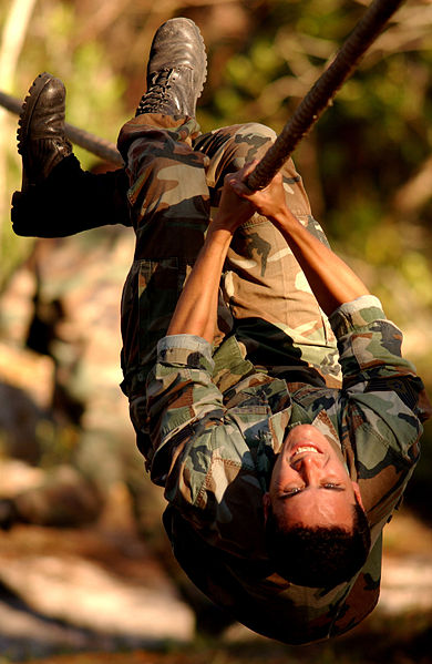 File:United States Air Force Tech. Sgt. pulls himself along a rope during the Dragon Challenge annual competition.jpg