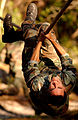 United States Air Force Tech. Sgt. pulls himself along a rope during the Dragon Challenge annual competition.jpg