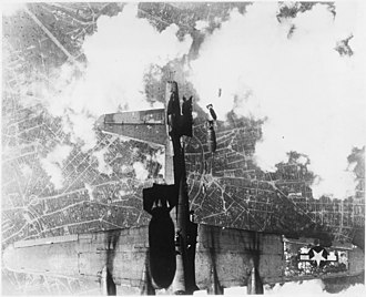Bombing of Berlin in World War II - USAAF B-17 damaged by mis-timed bomb release over Berlin, 19 May 1944.
