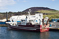 Vestmannaeyjar, trawler in the harbour with the Eldfell in the background.jpg