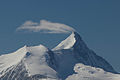 Weisshorn, Switzerland, creating a cloud again just like the wings of an airplane. (10766491563).jpg