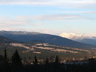 Coquitlam - Westwood Plateau, with Burke Mountain behind it and Golden Ears Provincial Park in the distance