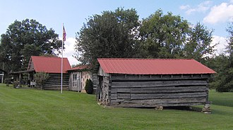 White Plains (Cookeville, Tennessee) - Smokehouse, now a log cabin (left) and corn crib (right) at White Plains