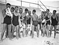 "Young male surfers (""The Pier Club Mob"") tease Alf ""Bait"" Gould about his backless swimsuit (a gift from his girlfriend), Bondi Beach, 10 October 1932, by Sam Hood (4116515330).jpg"