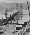 """Deadwood in 1876."" General view of the Dakota Territory gold rush town from a hillside above. By S. J. Morrow - NARA - 533172.tif"