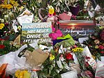 """Hate and terror will never divide us"" poster at Christchurch mosque shooting memorial, Thursday 21 March 2019.jpg"