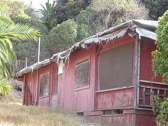 "La Jolla - The side view of ""Red Roost"", a bungalow cottage built in 1894, one of two that still exist on the road above La Jolla Cove"