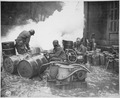 """Soldiers of the 161st Chemical Smoke Generating Company, U.S. Third Army, move a barrel of oil in preparation to refill - NARA - 531229.tif"