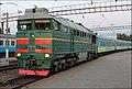 Тепловоз 2ТЭ116-1276 с пассажирским поездом на станции Жмеринка. - panoramio.jpg