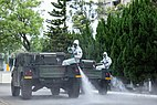 Taiwanese 33rd Chemical Corps sprayin disinfectant on a street in Taipei, Taiwan