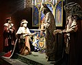 1. In 1507, King James IV of Scotland receives the new Sword of State in the Holyrood Abbey. Alexander Stewart, Archbishop of Saint Andrews holds the scepter. The Honors, the Scottish Crown Jewels, Edinburgh Castle, Scotland.jpg