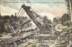 Steam shovel - 100-ton steam shovel mounted on railroad tracks, ca. 1919