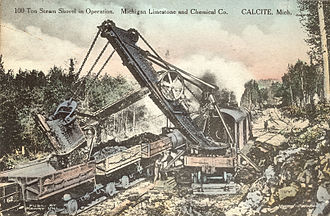 Steam shovel - 100-ton steam shovel mounted on railroad tracks, cc. 1919