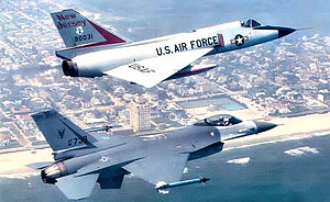 177th Fighter Wing - Last F-106 59-0031 of the 119th FIS with a newly assigned F-16C 81-739 of the squadron flying over the Atlantic City Beach, 1988