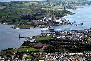 """A birds-eye view looking south-east towards Larne Harbour, <a href=""""http://search.lycos.com/web/?_z=0&q=%22Islandmagee%22"""">Islandmagee</a>, and down the length of <a href=""""http://search.lycos.com/web/?_z=0&q=%22Larne%20Lough%22"""">Larne Lough</a>. <a href=""""http://search.lycos.com/web/?_z=0&q=%22Chaine%20Memorial%22"""">Chaine Memorial</a> Tower can be seen in the left of the picture, with <a href=""""http://search.lycos.com/web/?_z=0&q=%22Ballylumford%20power%20station%22"""">Ballylumford power station</a> behind the ferry."""