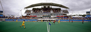 Football 7-a-side at the 2000 Summer Paralympics - Panoramic view of the venue for football 7-a-side during the 2000 Summer Paralympics. A match can be seen played on field in front of the stadium.