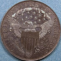 The reverse of a coin depicting a heraldic eagle